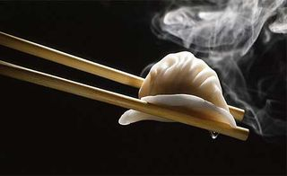 Chinese-dumpling-on-chopsticks