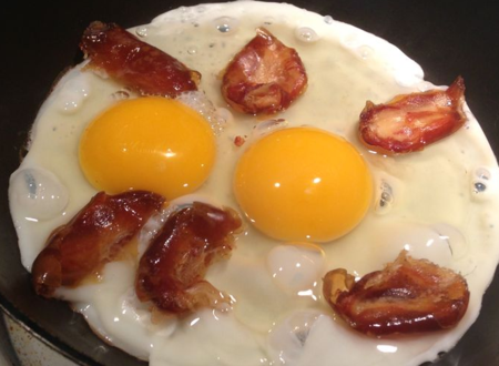 Eggs sunny side up with dates.